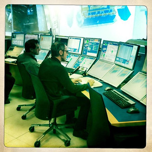 Ben Eshbach pretending to be directing particle collisions in CERN's ATLAS Control Room.