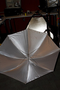 Various reflectors to help the small strobe become a larger light source