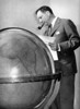 Juan Terry Trippe (Founder of PAN AMERICAN WORLD AIRWAYS) Checking his World Globe.