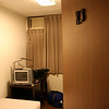 The first photo I took of my hotel room on campus at Tunghai University (in the Alumni Hall).  This was where I'd spend blissful hours relaxing and reading while recovering from the day's work and heat.  The wall-mounted air conditioning unit at the upper left was my best friend on this trip.  Saw many a strange show on the tiny TV there as well, including a couple of matches at Wimbledon (all in Chinese, of course).