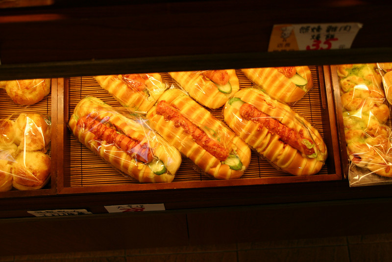 """We went to the bakery on campus one fine day and marveled at the strangeness of some of the items relative to what we might see in our bakeries back home.  This was some sort of hot dog in a """"bun"""" with """"sauce"""" and a """"pickle""""."""