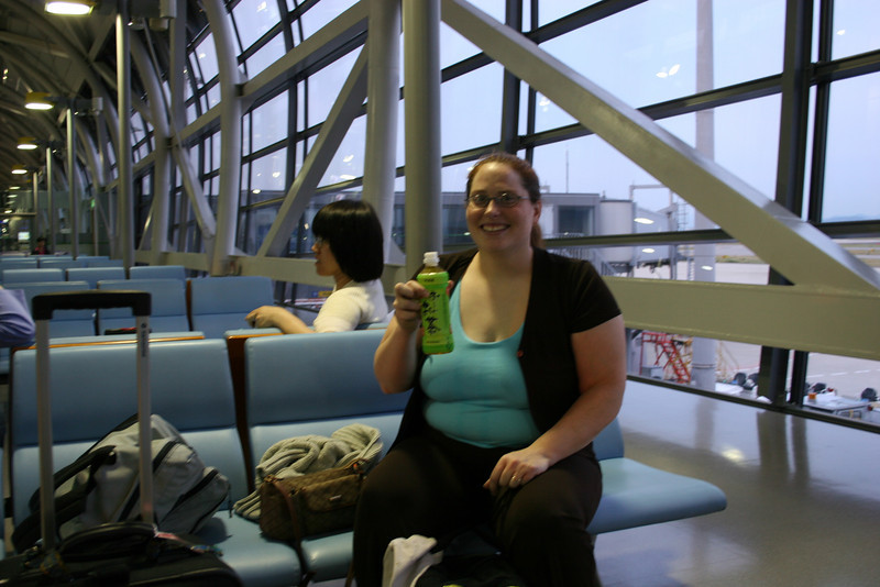 Nina drinking some delicious tea beverage while we waited for our transfer flight in Osaka.