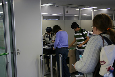Anne, in the blue shirt, about to lose her jelly (for the second time) in security in Osaka, Japan.