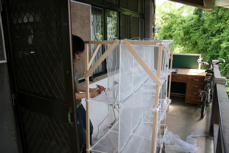 Unknown student gluegunning cage.