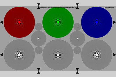 Zone plate test chart.  The highest frequency ring in the large circles is such that a white ring exactly resolves to 1 pixel when the middle gray background covers a 16:9 1920x1080 resolution (or when the light gray background covers a 3:2 1920x1280 resolution). Ideal to test video subsampling artifacts. The smaller circles have 2x (medium) or 4x the resolution and can measure up to 39 MPixel resolution sensors.  Use the original version as all resampled SmugMug sizes already suffer badly from Moiré. Even the original version has been resampled, although carefully (e.g., applying Gaussian blur). This was necessary to stay within SmugMugs constraints. But resampling a zone plate chart is an art. Also, it is only usable up to 3x rather than 4x rings. Contact me of you need a higher res version or a fully Moiré-free version.  Printing this image on anything smaller than A2 paper is a great test of a printers capabilities too. An Epson 3800 can print out this resampled test chart producing very mild Moiré only.  The red, green and blue circle can be used to better study color Moiré artifacts.  (c) Falk Lumo. The test chart may be used in testing, both commercial and amateur, provided the copyright notice is kept visible.