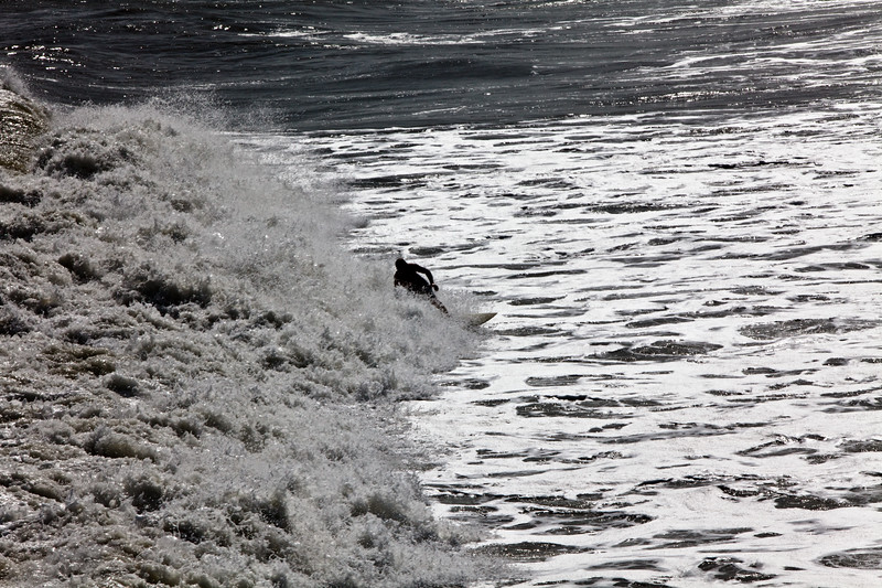 A surfer enjoys the waves.