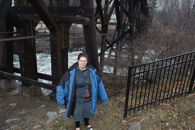 The bride-to-be under the trestle at Trestle Park in Franklin. This site survey was mostly about lighting the people and seeking the right background. This was my first shot and my flash is a little too hot.