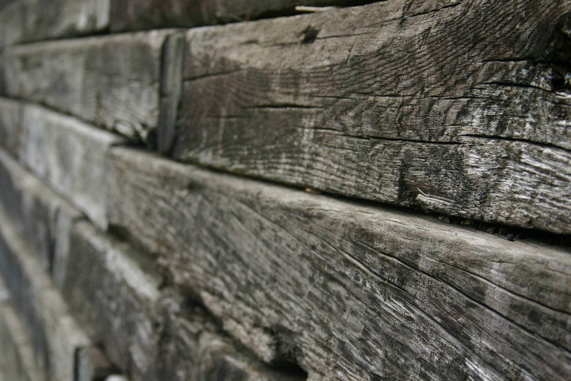 Retaining Wall If you\'ve got one of those yards which sits several feet above street level, you\'re probably familiar with this type of wall. I once owned a house with a retaining wall, but that wall was made of concrete. That wall had less character than these do, plus the whole thing was tilted