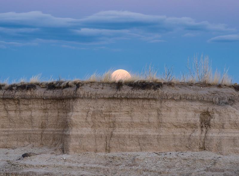 Perigee full moon rising over the South Dakota Badlands