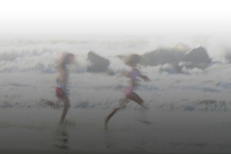 Children Running in the surf