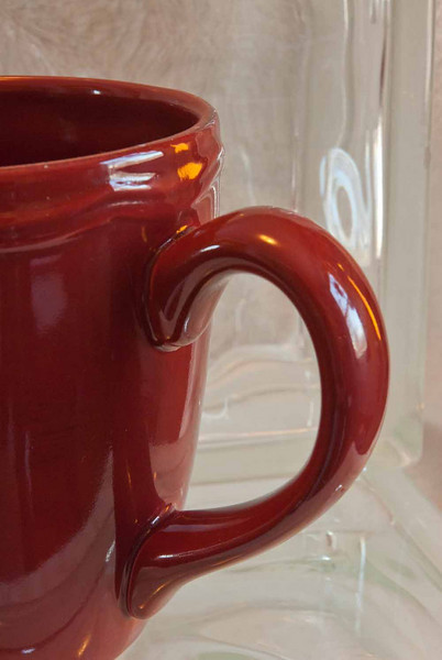 2/2011:  The color red:  a ceramic mug on glass block.