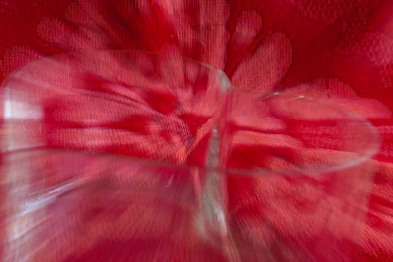 2/2011:  The color red:   A glass heart dish on a red background.  Two images are stacked, one sharp version and one zoomed version.