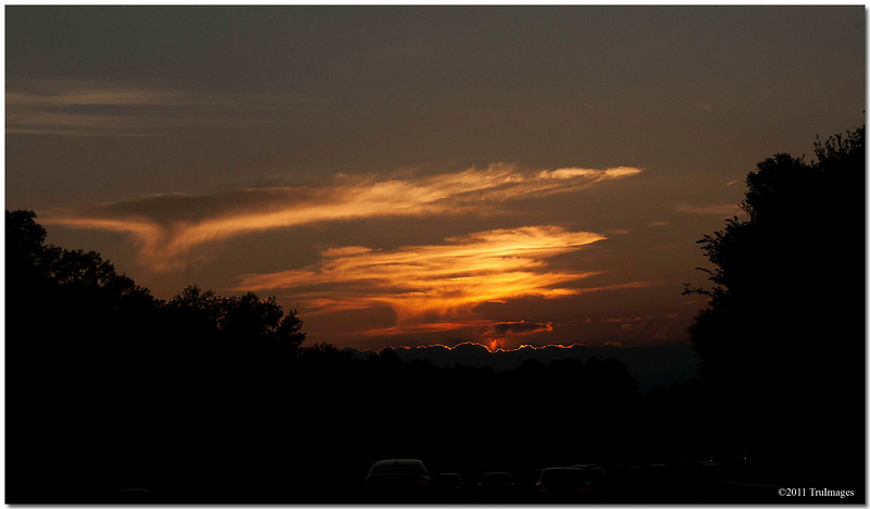 Sept 8<br /> A fiery sunset above the glowing rim of clouds