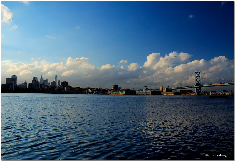 Oct 23 <br /> Delaware river<br /> <br /> Took a quick trip to NJ for a few days. This is a view of the Delaware river and the Walt Whitman bridge which connects Philadelphia to Gloucester City, New Jersey. The city in the distance is Philly. It was a beautiful afternoon with lots of happy clouds! i had hoped to return later for a nightime shot but never made it.  Best viewed in size X3 as noted in the comments by Perryfuquaphotos...thanks!