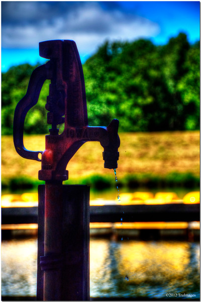 Sept 18 <br /> <br /> from the old days...<br /> <br /> I bet this old faucet poured some very tasty spring water during its days! Loving the bokeh!! (from the archives a few weeks ago..still busy with work!).