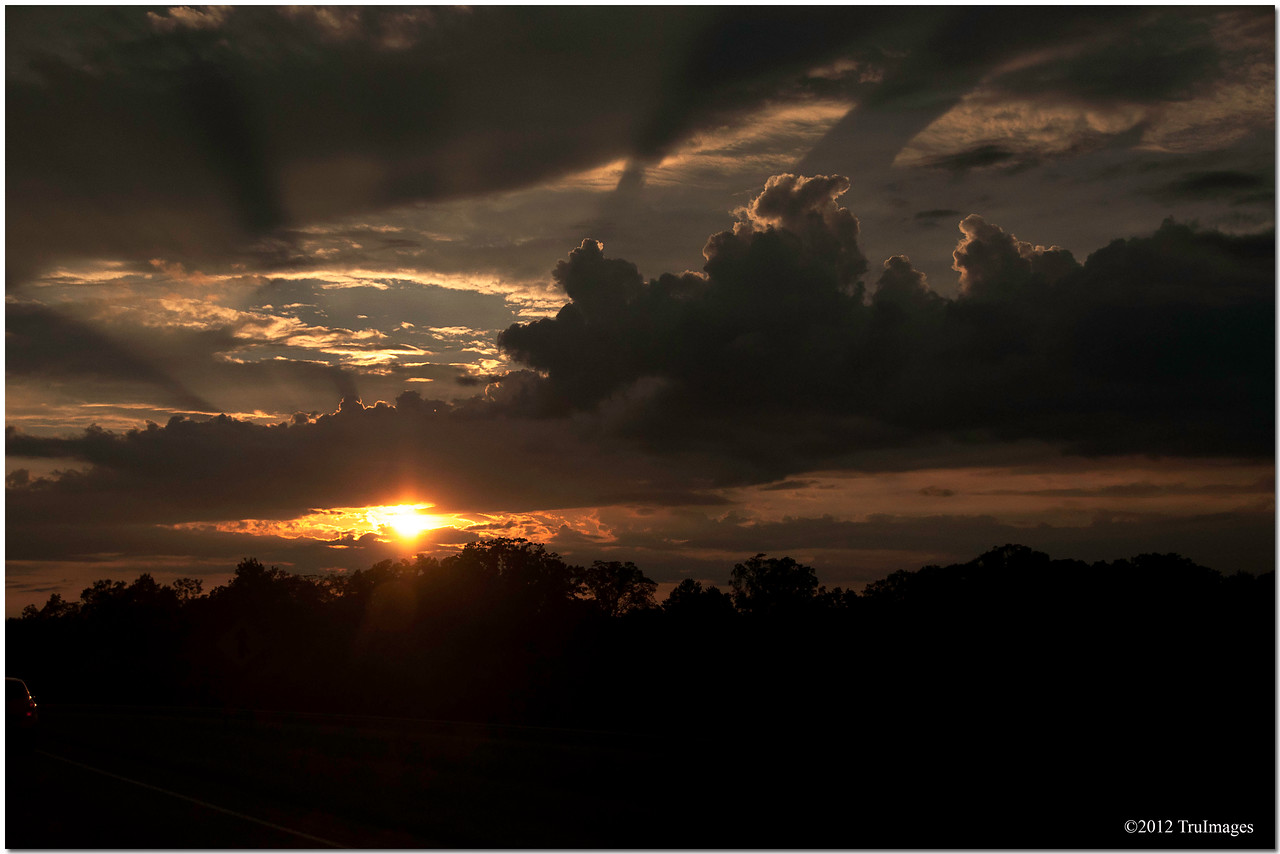 Jul 21<br /> Rays<br /> <br /> Heading towards the North Carolina mountains. This sunset welcomed us.
