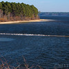 U=Underwater road<br /> <br /> Late upload for today and late for U day also!!<br /> Seagulls often stand on the reminants of an abandoned road that lies at the bottom of Jordan lake. When this man made lake was filled, laziness prevailed and the old road was buried beneath the waters. We see it from time to time partially exposed as it is here but sometime fully exposed when the lake levels are far below normal. Weve stood where the seagulls are many times!