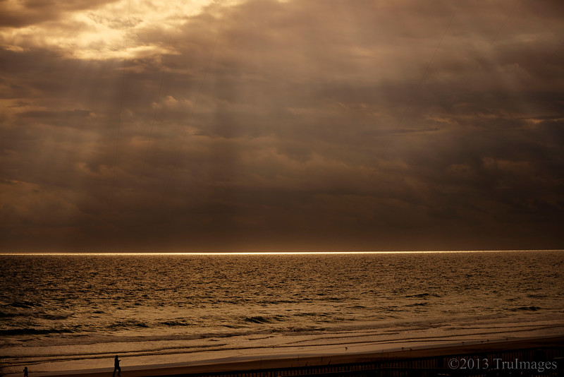 Dec 15<br /> W=Water, waves and sun rays<br /> <br /> We were having breakfast when I noticed the sun lit rim along the ocean. Then rays appeared in the sky! It was a magical moment!