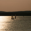 Aug 5<br /> Carefree<br /> <br /> A couple of sailboats dance in the glistening waters of the lake.