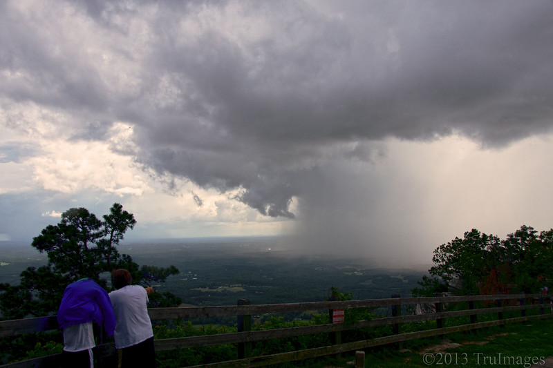 Jul 12<br /> Stormy weather<br /> <br /> Onlookers watch an approaching storm at Pilot Mountain state park. These showers happened about every 20 minutes or so! We had to keep our eyes on the skies to make sure we did not get rained on during our walks on the trails.<br /> <br /> Thanks for your wonderful comments on the squatters photo yesterday!<br /> Happy Friday everyone!