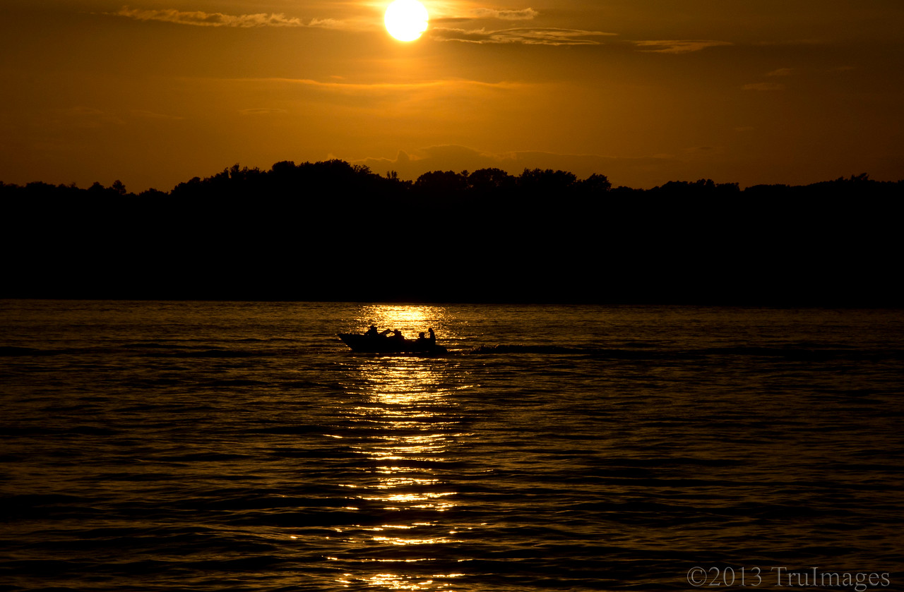 Jul 22<br /> Summer evenings <br /> <br /> A boat lingers in the lake, while the sun slowly sets behind it. What a great way to spend the day!<br /> <br /> Thanks for all of your comments on my B entry in the alphabet challenge!  Lots of fun! Thanks Donna for this idea!