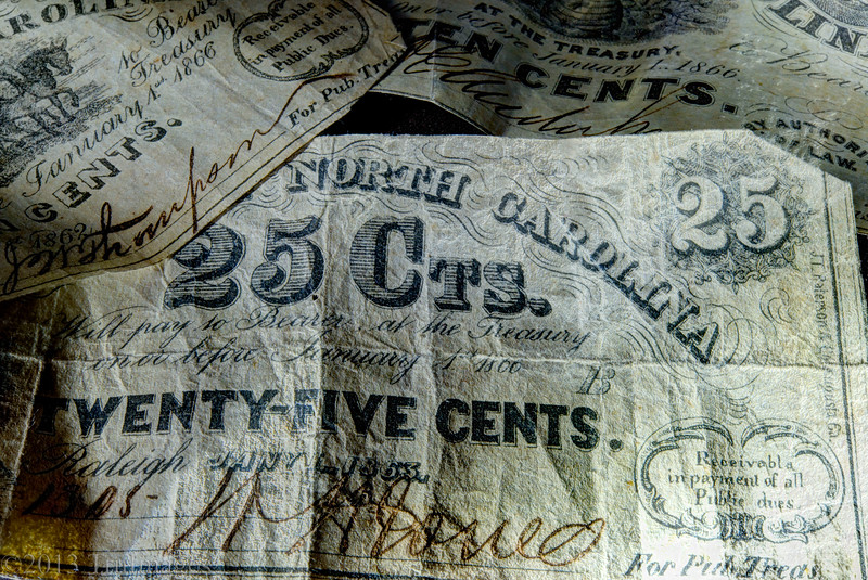 Jul 28<br /> C= Cents<br /> <br /> 25 cents in North Carolina currency from the mid 1800's.