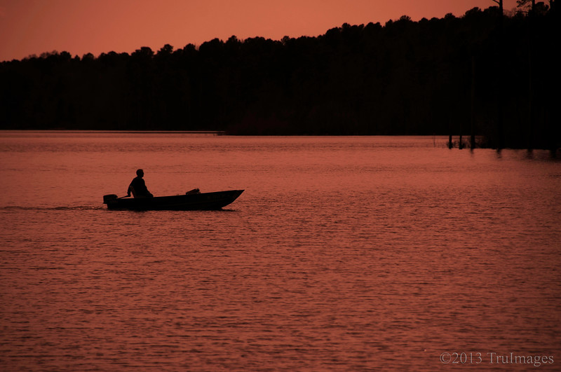 Apr 17<br /> Ending the day...<br /> <br /> This fisherman slowly made his way to the docks after a day of fishing at Falls Lake. The lighting was boring so I decided to use an orange filter to make the scene a little more interesting.<br /> <br /> Thanks for the warm response to the corsage photo yesterday... Happy Wednesday!!