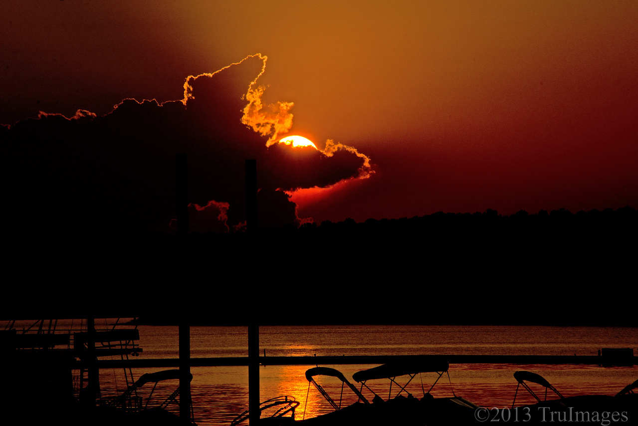 Jul 10<br /> Sunset <br /> <br /> The clouds and sun created an interesting sunset over Jordan Lake.<br /> <br /> Thanks for viewing and commenting! Very much appreciated!