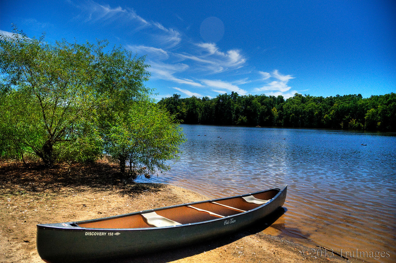 Apr 11<br /> The lonely canoe<br /> <br /> From the Bond Lake archives, a canoe waits patiently in the warm afternoon sun.<br /> <br /> Thanks so much for your wonderful comments on my old mill photo yesterday!! Still recovering from my cold but at least I am up and moving again! Yaye!!