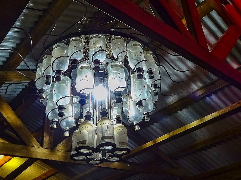 A must-have for the man-cave!  Chandelier of Pendleton whiskey bottles at Bob's Cowboy Bar, Guymon, OK.<br /> Photo © Cindy Clark