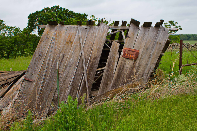 The leaning remnants of a farm building in Cowley County, Kansas.<br /> Photo © Carl Clark