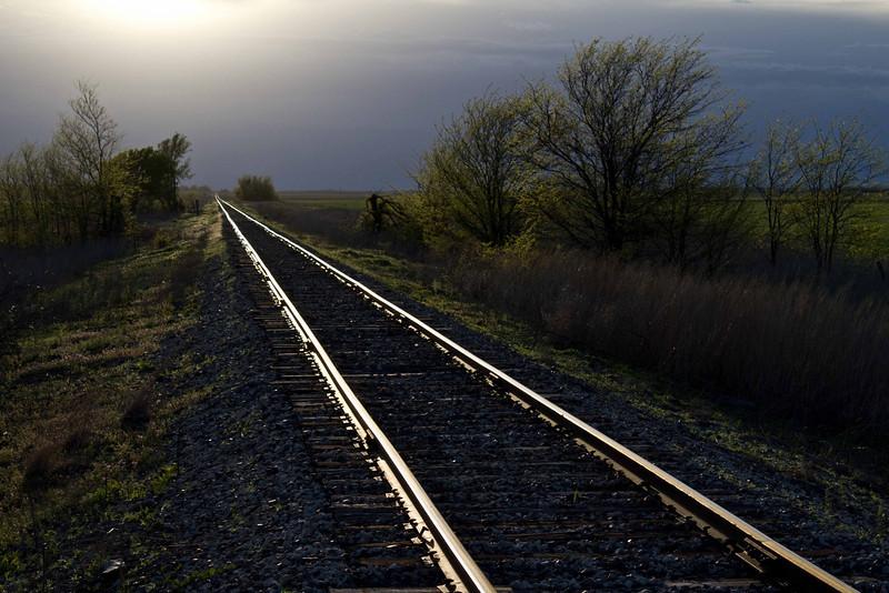 Tracks to the sun near Otis, Kansas.<br /> Photo © Carl Clark