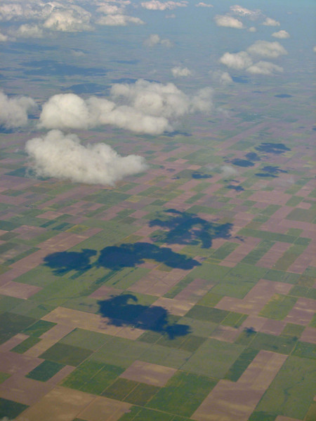 Cloud shadows on farmland in the Texas Panhandle.<br /> Photo © Carl Clark