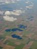 Cloud shadows on farmland in the Texas Panhandle.<br /> Photo © Carl Clark