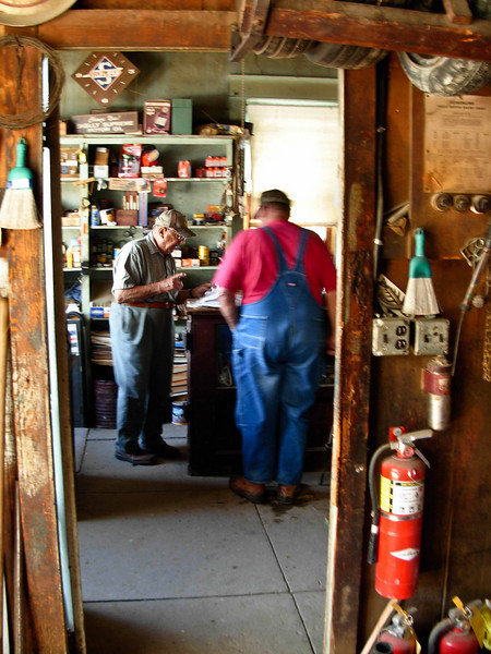 Norman Kellerman helps a customer at Stuttgart Oil in Stuttgart, Kansas.<br /> Photo © Carl Clark