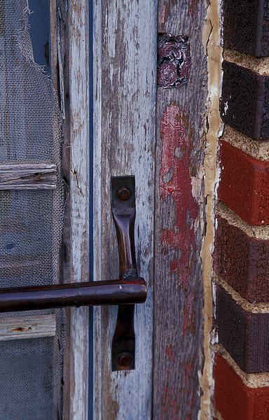 I love old screen doors.  This one is in Otis, Kansas.<br /> Photo © Cindy Clark