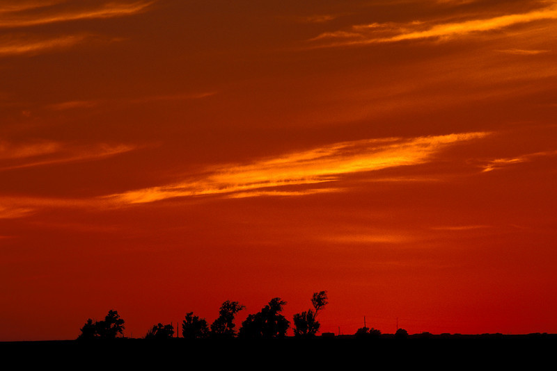The sky dominates this part of the country.  Sunset near Guymon, Ok.<br /> Photo © Cindy Clark