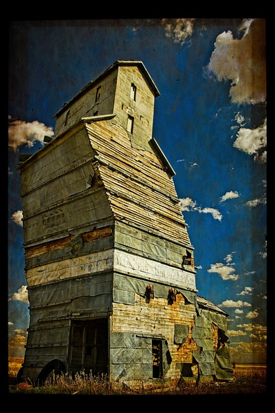 Oklahoma's Leaning Tower - the old grain elevator in Adams.<br /> Photo © Cindy Clark