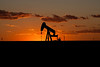 Oil rig at sunset near Guymon, Oklahoma.<br /> Photo © Cindy Clark
