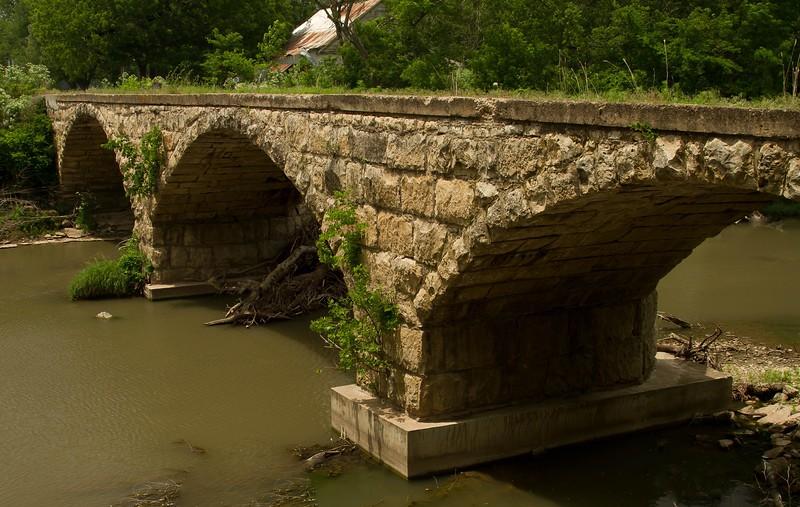 A rare triple-arched stone bridge in rural Kansas.<br /> Photo © Cindy Clark