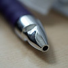 The ubiquitous purple pen.