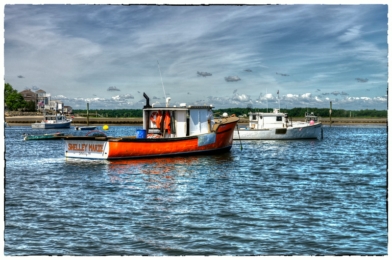 One of the many fishing boats in the harbor at Eastman's in Seabrook, NH.