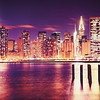 <h2>New York City Skyline - Skyscrapers at Night </h2> - By Vivienne Gucwa<br><br>  In the blink of an eye the city's lights twinkle like stars in a universe that rises up from the ground to the surface of a darkening sky.<br><br>  And all at once, everything else seems to fade away.<br><br>  ---<br><br>  This was taken on a frigid evening at Gantry Plaza State Park in Queens with wind gusts that roared across the river to the rocks I was teetering on with nothing more than my tripod and utterances of hope that the wind would let up for just a few seconds.<br><br>  It didn't.<br><br>  But as I stood there frozen in place for what seemed like the longest 30 seconds of the night, the city's glow rivaled that of a roaring fire and everything else seemed to pale in comparison.<br><br> ---<br><br>