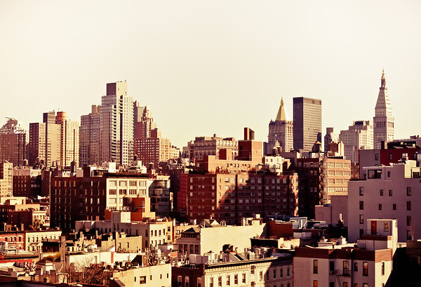 <h2>New York City Rooftops Above Midtown </h2> - By Vivienne Gucwa  The city is comprised of so many tiny urban worlds: planets and stars that inhabit a larger universe. Until I understood that fact about New York City, I couldn't properly begin to understand how to explore it.  When you spend your days looking out of any number of windows in a city as large as New York City, the urban world seems to shrink to include only the views that you are accustomed to seeing on a regular basis.  Therefore, when you come across a view that takes you out of your small urban frame of reference and plants you outside of that view and outside of yourself for a few moments, it's a bit finally coming to an understanding that the world you inhabit daily is just part of a larger picture.   And as your universe expands when you stand on a rooftop gazing out onto the planets and stars that populate its view, pieces of you expand along with it and you are changed forever.  ---
