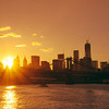 <h2>New York City - Summer Sunset </h2> - By Vivienne Gucwa<br><br>  Summer in New York City: <br><br>  ...popsicles melting on tongues like summer snowflakes, ice cream kisses under trees, sand between toes, ocean waves, afternoon daydreams, roller-coaster laughter, running barefoot through fountains, fire-escape barbecues, freckles on warm skin, open fire hydrant dancing, shaved ices on corners, stoop gossip, bicycles against trees, clothesline clothes swaying against the skyline, ferry boat waves and river lullabies, evening breezes, and sunsets that steal their way into hearts...<br><br>   ---<br><br>   This was taken on a boat in the East River overlooking the Manhattan Bridge and New York City skyline in lower Manhattan.<br><br>   ----<br><br>