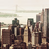<h2>New York City Skyline - Skyscrapers of the Financial District as seen from Midtown</h2> - By Vivienne Gucwa  I love the variety of skyscrapers that make up the New York City skyline in lower Manhattan. They jut up like stalagmites from the city floor. This skyline view is usually photographed from the other side usually across the East River but this is a view of the skyline as seen from midtown Manhattan. Prominent works of architecture include New York by Gehry and the Municipal Building.   ---