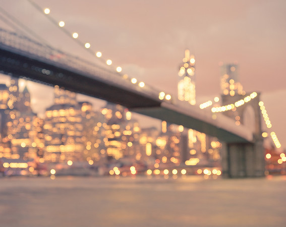 <h2>Brooklyn Bridge at Night - New York City</h2> - By Vivienne Gucwa  If you stop to squint long enough  all the dreams whispered on the wind during the day  flicker like fire-flies when the evening  stretches out across the sky  and the rain washes the city's despair away  so it can dream itself into another sunrise.  ----  This was taken on a gorgeous evening overlooking the New York City skyline and the Brooklyn Bridge in Brooklyn. The sky filled with enormous clouds shortly after sunset as the city's lights sprinkled themselves like glitter all over the evening cityscape and it was as if everything else melted away.     ----