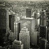 <h2> Looking Out Over The New York City Skyline</h2> - By Vivienne Gucwa  A classic view looking out over the cavernous skyscrapers of midtown Manhattan towards the Manhattan Bridge and the Brooklyn Bridge in the distance.  ---