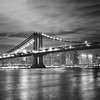 <h2>Manhattan Bridge - Night - New York City </h2> - By Vivienne Gucwa<br><br>   The world stops spinning on its axis <br><br>  as the city's lights search through the night<br><br>  for hearts that flutter to the <br><br>  syncopation of its pulsating lights.<br><br>  ----<br><br>  This was taken on a stormy night in Brooklyn as the waves in the East River pounded the piers and the wind whipped against the faces of the few brave souls who were still standing at the edge of Brooklyn Bridge Park hoping to catch a first glimpse of the city's lights as they flickered into view. <br><br>  ---<br><br>