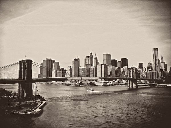<h2>Creased by Time - The Brooklyn Bridge and the New York City Skyline</h2> - By Vivienne Gucwa   The outline of the city's memory rests in dreams so delicate they are paper thin and creased by time.   As hope escapes from excited utterances of urban dreamers, it etches itself into every structure: a permanent impression emblazoned on the cityscape secured in the vault of eternity.  ---